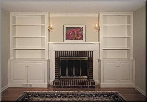 Built Bookcases Around Shallow Fireplace
