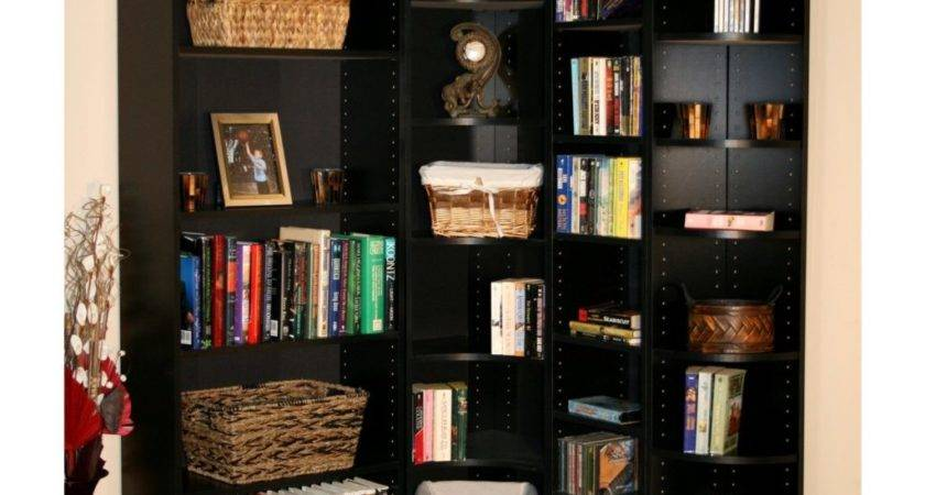 Corner High Black Wooden Bookcase Many Shelves Placed