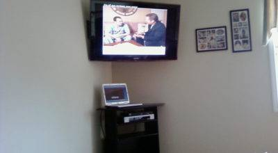 Corner Mounted Home Theater Installation